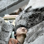 A survivor is seen among the rubble of a collapsed building at the earthquake-affected Beichuan County of Mianyang City